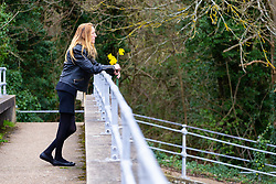 Lisa Lane, 49, girlfriend of the late Scott Wilkinson, stands on a bridge over the lock cut, the last place she saw her partner, a dedicated pike fisherman, who was murdered by teenage brothers Shane Crawt, 19, and Lenny Crawt, 18, on Donkey Island at Walton-On-Thames in Surrey. Walton-On-Thames, Surrey, March 15 2019.