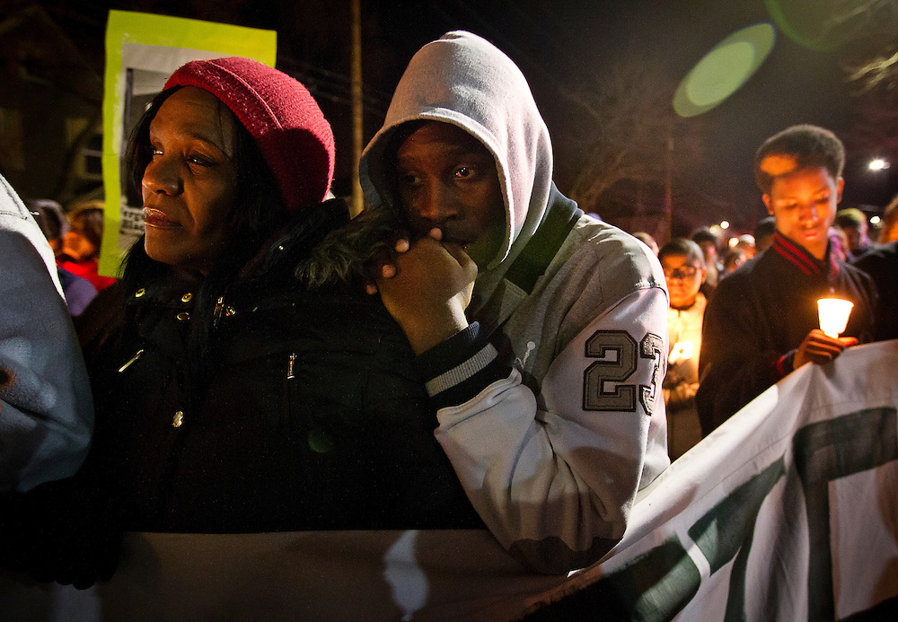 Tamale Robinson rests his head on his mother Lynn's shoulder during a candlelight vigil on Williamson Street on Sunday night for Tony Robinson, March 8, 2015. Robinson was an unarmed black teen shot on Friday by Madison Police inside his home. REUTERS/Ben Brewer (UNITED STATES)