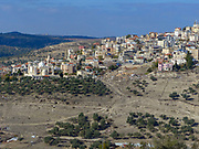 Israel, Galilee. Aerial view of an Arab village built on a mountain side
