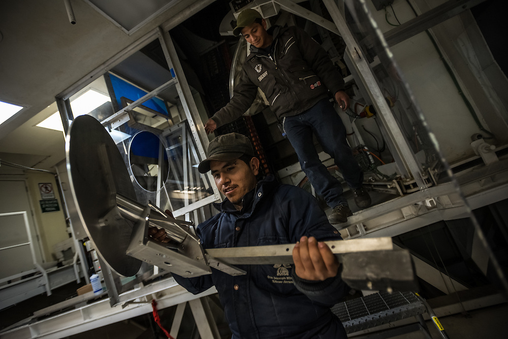 PICO DE ORIZABA NATIONAL PARK, PUEBLA, MEXICO - MARCH 26, 2015: Alejandro Larracilla Castillo (right) and Jonathan Velasques, (left), members of the LMT local night staff, change the position of the M4 mirror, that guides radio waves into the ultra sensitive receiver, inside the heart of the Large Millimeter Telescope. The mirrors must be perfectly aligned in order to record data from the black hole. CREDIT: Meridith Kohut for The New York Times