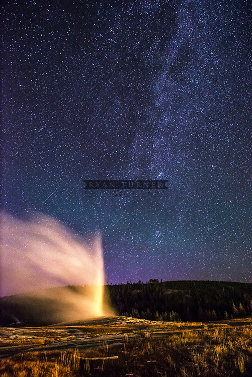 Old Faithful erupting in the moon light in Yellowstone National Park.  Limited Edition - 150