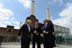 Prime Ministers of UK and Malaysia break ground at Battersea Power Station redevelopment.<br /> (L-R) Boris Johnson, Mayor of London, Prime Minister David Cameron and and Prime Minister Najib Razak  during a visit to the Battersea Power Station to celebrate ground breaking at London's most visionary and eagerly anticipated new development – eighty years after it first generated electricity and thirty years since it was decommissioned. <br /> They were also joined by were joined by Boris Johnson, Mayor of London; Tan Sri Liew Kee Sin, President of S P Setia and Chairman of the shareholders' consortium; Tan Sri Dato' Mohd Bakke Salleh, President of Sime Darby; Datuk Shahril Ridza Ridzuan, Chief Executive Officer of Employees' Provident Fund (EPF) and Rob Tincknell CEO of Battersea Power Station Development Company.<br /> London, United Kingdom<br /> Thursday, 4th July 2013<br /> Picture by Andrew Parsons / i-Images