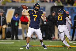 Sep 8, 2018; Morgantown, WV, USA; West Virginia Mountaineers quarterback Will Grier (7) throws a pass during the third quarter against the Youngstown State Penguins at Mountaineer Field at Milan Puskar Stadium. Mandatory Credit: Ben Queen-USA TODAY Sports