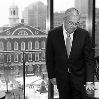 Mayor Thomas Menino pauses at the desk where he has worked for the last 20 years during his last morning in the Mayor's Office at Boston City Hall, Monday, January 06, 2014.