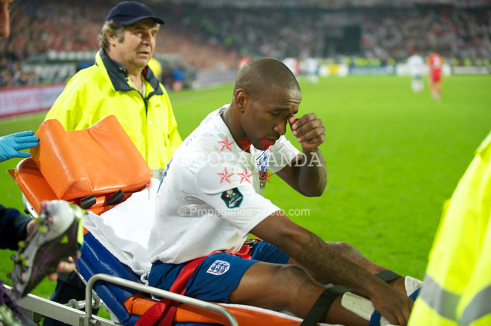 BASEL, SWITZERLAND - Tuesday, September 7, 2010: England's Jermain Defoe is carried off injured during the UEFA Euro 2012 Qualifying Group G match against Switzerland at St. Jakob-Park. (Pic by David Rawcliffe/Propaganda)