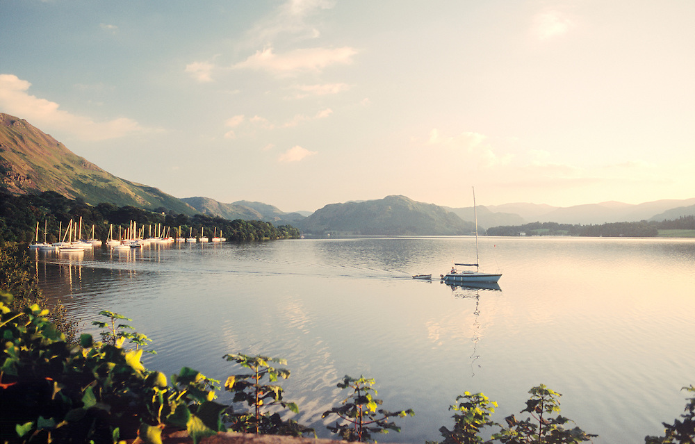 Ullswater, Lake District National Park, Cumbria, England. Looking southwest toward Howtown from Sharrow Bay. Sailboat