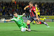 Bournemouth midfielder Ryan Fraser strikes at goal as Burton Albion goalkeeper Kieran O'Hara challenges during the EFL Cup match between Burton Albion and Bournemouth at the Pirelli Stadium, Burton upon Trent, England on 25 September 2019.