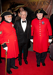 Director Steven Spielberg with Chelsea Pensioners  at the premiere of his new film War Horse in London, Sunday 8th January 2012.  Photo by: Stephen Lock / i-Images