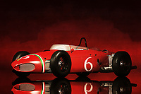 From the moment you see something like the Ferrari 156, your heart begins to race. This vehicle could be seen as an iconic example of our constant fascination with two things. We love to build complex, powerful machines. We like it even more, when those machines can go really, really fast. This art piece depicting the Ferrari 156 plays with both of those thoughts in the best way possible. It isn&rsquo;t difficult to hear the sound of that perfect engine, ripping the racetrack as it hugs a turn that has to be seen to be believed. This art is available in the form of wall art, t-shirts, and interior products.<br /> <br /> About the car: The Ferrari 156 was a racecar made by Ferrari in 1961 to comply with then-new Formula One regulations that reduced engine displacement from 2.5 to 1.5 litres, similar to the pre-1961 Formula Two class for which Ferrari had developed a mid-engined car also called 156. Ferrari started the season with a 65 degrees Dino engine, then replaced by a new engine with the V-angle increased to 120 degrees and designed by Carlo Chiti. This increased the power by 10 hp (7 kW). Bore and stroke were 73.0 x 58.8 mm (2.3 in) with a displacement of 1,476.60 cc and a claimed 190 hp (142 kW) at 9,500 rpm. For 1962 a 24-valve version was planned with 200 hp (149 kW) at 10,000 rpm, but never appeared. In 1963 the 12-valve version fitted with Bosch direct-fuel injection instead of carburetors achieved that power level. The last victory for the Ferrari 156 was achieved by Italian Lorenzo Bandini in the 1964 Austrian Grand Prix. A V-6 engine with 120 degree bank is smoother at producing power because every 120 degree rotation of engine crankshaft produces a power pulse. Phil Hill won the 1961 World Championship of Drivers and Ferrari secured the 1961 International Cup for F1 Manufacturers, both victories achieved with the 156.