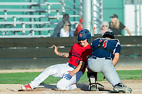 KELOWNA, BC - JULY 17: Hunger Montgomery #3 of the Wenatchee Applesox attempts to tag Jake Fischer #19 of the Kelowna Falcons as he slides into home plate at Elks Stadium on July 17, 2019 in Kelowna, Canada. (Photo by Marissa Baecker/Shoot the Breeze)