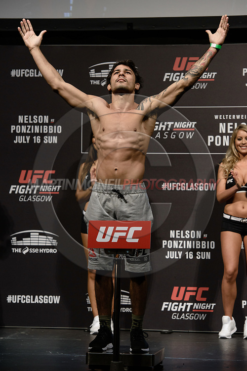 "GLASGOW, UNITED KINGDOM, JULY 15, 2017: Alexandre Pantoja on stage during the ceremonial weigh-in for ""UFC Fight Night Glasgow: Nelson vs. Ponzinibbio"" inside the SSE Hydro Arena in Glasgow"