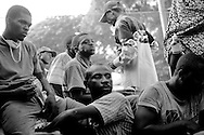 Men take a break from unloading food provided by USAID for victims of the recent earthquake in Port-au-Prince, Haiti.