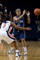 Virginia guard Paulisha Kellum (3) knocks the ball away from Rhode Island guard Mia Marcus (11).  The Virginia Cavaliers women's basketball team defeated the Rhode Island Rams 89-53 at the John Paul Jones Arena in Charlottesville, VA on January 9, 2008.
