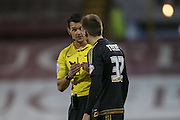 referee Andrew Madeley has a word with Nottingham Forest midfielder Robert Tesche  during the Sky Bet Championship match between Burnley and Nottingham Forest at Turf Moor, Burnley, England on 23 February 2016. Photo by Simon Davies.