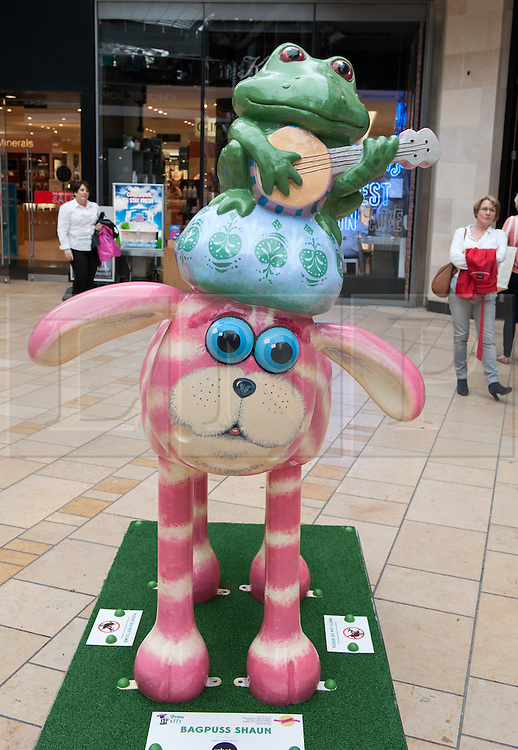 © Licensed to London News Pictures. 06/07/2015. Bristol, UK.  SHAUN THE SHEEP, 'Bagpuss Shaun' designed by Peter Firmin.  The Shaun in the City trail starts today with 70 5ft tall Shaun the Sheep sculptures originally devised by Aardman Animations with these sculptures decorated by various artists.  The Shaun trail happened in London in the spring, and the Bristol Trail lasts till 31 August.  At the end of September all 120 Shaun sculptures will be viewable together in Covent Garden.  All sculptures will then go to auction on 8th October, with proceeds from the Bristol sculptures benefitting The Grand Appeal which funds pioneering medical equipment, facilities, and comforts for patients at Bristol Children's Hospital. Proceeds from the London sculptures will benefit Wallace & Gromit's Children's Charity supporting children's hospitals and hospices throughout the UK. Photo credit : Simon Chapman/LNP