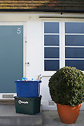 Two recycling containers outside building