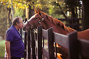 (1992) Frank Nastasi plants a kiss on his horse Compadre's muzzle, which was DNA tested to prove his Thoroughbred bloodline. Pine Bourne Horse Farm, Long Island, NY. DNA Fingerprinting. MODEL RELEASED.