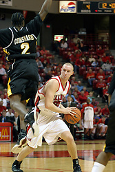 08 January 06  Neil Plank holds his ground but leans left as  PJ Couisnard flies towards him...The Illinois State Redbirds come up short against the Witchita State Shockers.  The Shockers put on a 2nd half show that left the Redbirds trailing 56 - 47 at the bell.  Dana Ford of the Redbirds matched his career high with 16 points, adding 7 boards and 4 steals...Redbird Arena, Illinois State University  campus, Normal, Illinois...