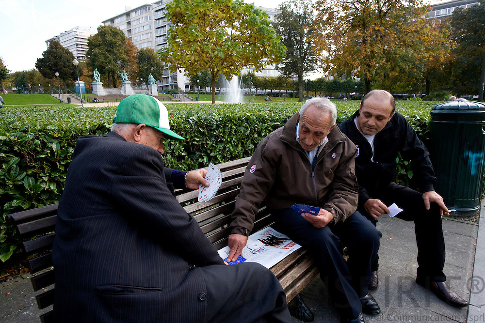 BRUSSELS - BELGIUM - 14 OCTOBER 2008 -- Elderly men playing cards on a bench in a Brussels park. Photo: Erik Luntang.