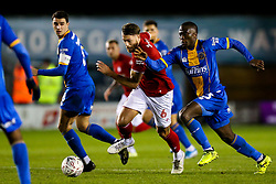 Nathan Baker of Bristol City is challenged by Daniel Udoh of Shrewsbury Town - Rogan/JMP - 14/01/2020 - Montgomery Waters Meadow - Shrewsbury, England - Shrewsbury Town v Bristol City - Emirates FA Cup Third Round Replay.