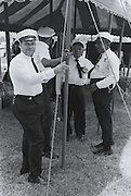 Four band men stand around the New Orleans Fairgrounds during the third Louisiana Jazz and Heritage Festival in New Orleans in 1072.