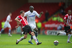 SHEFFIELD, ENGLAND - Saturday, March 17, 2012: Tranmere Rovers' Enoch Showunmi in action against Sheffield United's Michael Doyle during the Football League One match at Bramall Lane. (Pic by David Rawcliffe/Propaganda)