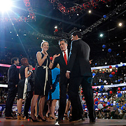 Republican presidential nominee Mitt Romney and running mate Paul Ryan celebrate with their families Thursday, Aug. 30, 2012 on the final day of the Republican National Convention at the Tampa Bay Times Forum in Tampa, Fla.