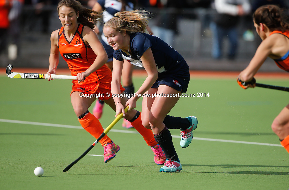 Auckland's Maddison Evans beats the defence. Auckland v Midlands, Final - Womens National U18 Regional Hockey Tournament, Napier, New Zealand. Saturday, 12 July, 2014. Photo: John Cowpland / photosport.co.nz