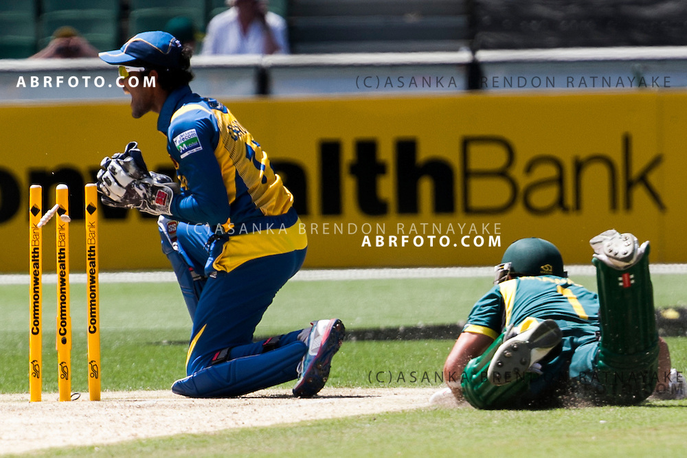 Dinesh Chandimal attempts to run out a batsmen during game 1 of the Commonwealth Bank Series Australia v Sri Lanka played at the Melbourne Cricket Ground in Melbourne,Victoria, Australia. Photo Asanka Brendon Ratnayake