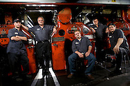 From left, Utica Observer-Dispatch pressmen Tim Mierek, Phil<br />