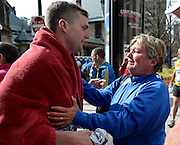 Karen Terry, right, greets Sean Terry shortly after two bombs went off near the finish line of the Boston Marathon on April 15, 2013. Three people were killed, and more than 200 more injured.