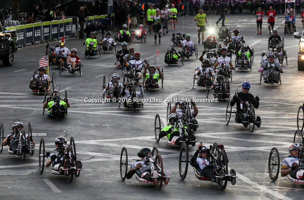 Wheelchair runners take off from Dodger Stadiumduring the 31st Los Angeles Marathon in Los Angeles, Sunday, Feb. 14, 2016. The 26.2-mile marathon started at Dodger Stadium and finished at Santa Monica.  (Photo by Ringo Chiu/PHOTOFORMULA.com)<br /> <br /> Usage Notes: This content is intended for editorial use only. For other uses, additional clearances may be required.