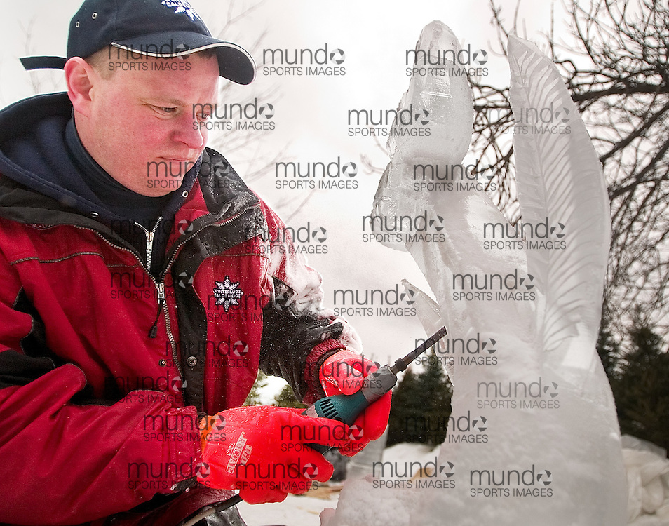 Ottawa, Ontario ---06/2/4---  Stan Kolonko from Auburn New York carves a flower during Winterlude's international ice carving competition at Confederation Park Saturday afternoon..GEOFF ROBINS The Ottawa Sun<br />