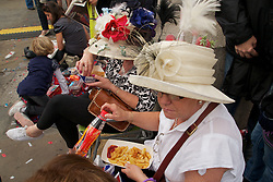 Trafalgar Square, UK  29/04/2011. The Royal Wedding of HRH Prince William to Kate Middleton. Party goers in their finery in Trafalgar Square, London lunching on chips and ketchup. Photo credit should read PAUL TREACY/LNP. Please see special instructions. © under license to London News Pictures