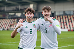 NEWPORT, WALES - Tuesday, November 19, 2019: Wales' Neco Williams and captain captain Morgan Boyes celebrate a 2-0 victory over Kosovo after the UEFA Under-19 Championship Qualifying Group 5 match between Kosovo and Wales at Rodney Parade. (Pic by Paul Greenwood/Propaganda)