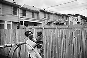 "BIRMINGHAM, AL – MAY 20, 2016: Marquita Smiley, 33, holds her 2-year-old son, Zaidan, in the backyard.<br /> <br /> While pregnant in 2014, Marquita Smiley was prescribed Zofran to help her cope with severe morning sickness. At her 20 week ultrasound, the OB/GYN discovered signs that her son was suffering from hypoplastic left heart syndrome – a rare heart defect resulting in a severely underdeveloped heart. Months later, her newborn Zaidan was placed on a transplant list, and he ultimately underwent surgery as a 2-month-old to replace the failed organ.<br /> <br /> Initially developed as a drug to help cancer patients suffering from the side-effects of chemotherapy, Zofran (generic name ondansetron) has become widely prescribed by doctors to treat morning sickness among pregnant mothers. Pharmaceutical companies point to studies that deny any link between the drug and birth defects, yet somehow ondansetron has avoided the strict barrier of clinical trials required by the Food and Drug Administration to validate its use among pregnant women. Absent of any data, critics argue that pregnant women and their babies are susceptible to unknown risks.<br /> <br /> It wasn't until months after Zaidan's heart transplant that the Zofran controversy was brought to Marquita Smiley's attention. ""Mentally more than anything it was life changing,"" Smiley said. ""We watched him code several times, so I really don't want anybody to have to experience this. If [the drug] is what caused it, people need to know what they're getting into."""
