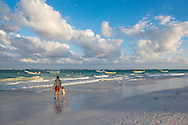 Father and daughter on the beach in Tulum, Mexico.