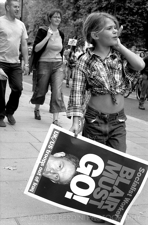 A young girl joins the millions people being part of the largest UK political demonstration to date. Hyde Park, London. 15/02/2003