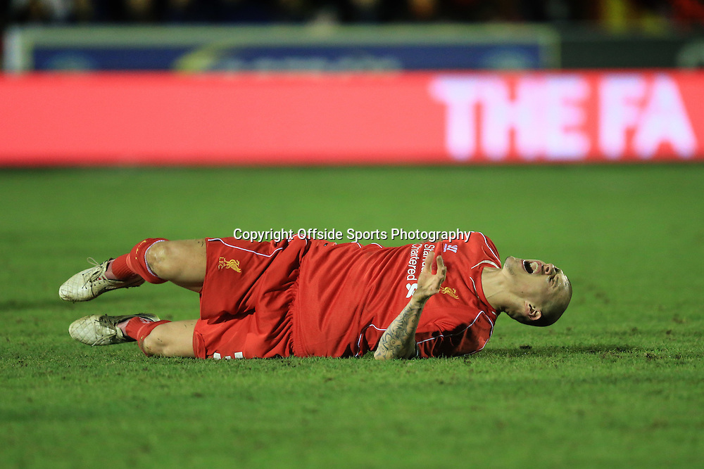 5 January 2015 - The FA Cup 3rd Round - AFC Wimbledon v Liverpool - Martin Skrtel of Liverpool reacts to injuring his back - Photo: Marc Atkins / Offside.
