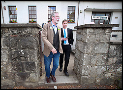 Sinn Fein's Party leader Gerry Adams leaves his local Polling Station with local candidate Matt Carthy after voted in the local and European Elections at Doolargy National School in Ravensdale, County Louth, Ireland,  Friday May 23rd. Polling stations will remain open until 10pm. Almost 2,000 candidates are contesting the 949 local authority seats, while 41 hopefuls are in the race for 11 MEP seats spread over three constituencies while counting has begun in the local elections in Northern Ireland. Over 900 candidates are competing for the 462 seats on 11 new local authorities. Final results are expected to be known by tomorrow afternoon. Counting in the European Elections begins in Belfast on Monday morning. Friday, 23rd May 2014. Picture by  i-Images / i-Images