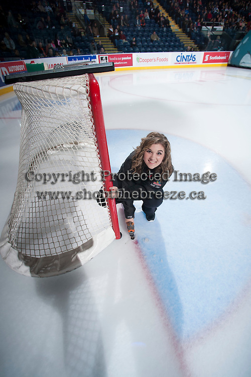 KELOWNA, CANADA - NOVEMBER 6: A member of the Kelowna Rockets ice crew prepares the net for the game against the Red Deer Rebels on NOVEMBER 6, 2013 at Prospera Place in Kelowna, British Columbia, Canada.   (Photo by Marissa Baecker/Shoot the Breeze)  ***  Local Caption  ***