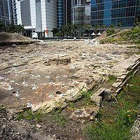 Remnants of the north wall from the Flagler Royal Palm Hotel and post holes from an ancient  dwelling in the Tequesta archaeology site at the Met Square development,  downtown Miami. Site managed by Archaeological and Historical Conservancy (AHC).