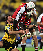 Jack Lam tries to tackle Lions lock Wikus Van Heerden. Super 15 rugby match - Hurricanes v Lions at Westpac Stadium, Wellington, New Zealand on Saturday, 4 June 2011. Photo: Dave Lintott / photosport.co.nz