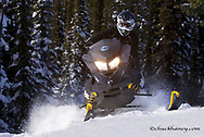 Snowmobiling on Desert Mountain in the Flathead National Forest, Montana, USA MR