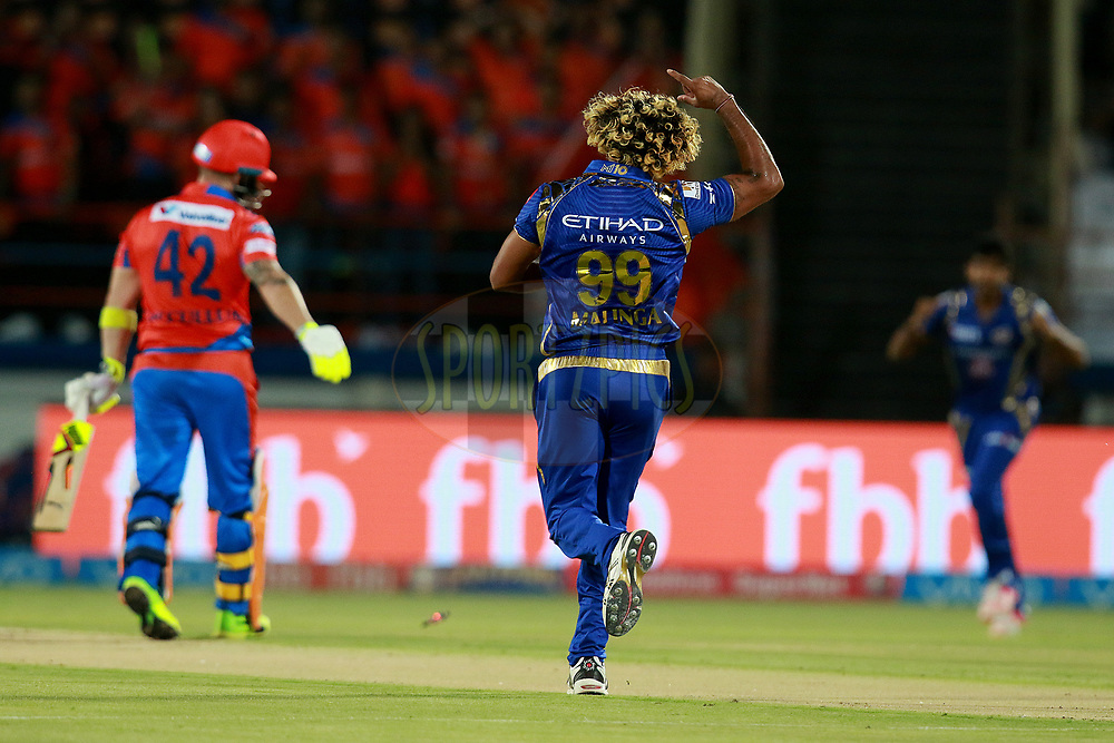 Lasith Malinga of MI celebrates after takes Brendon McCullum of GL wicket during match 35 of the Vivo 2017 Indian Premier League between the Gujarat Lions and the Mumbai Indians  held at the Saurashtra Cricket Association Stadium in Rajkot, India on the 29th April 2017<br /> <br /> Photo by Rahul Gulati - Sportzpics - IPL