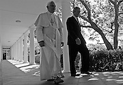 DATE IMPORTED:April 16, 2008U.S. President George W. Bush walks with Pope Benedict XVI through the colonnade at the White House in Washington, April 16, 2008.  REUTERS/Jim Young