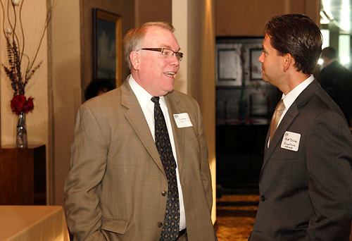 A. J. Wagner of Dayton (left) and Matt DiCicco of Freund, Freeze & Arnold during the Dayton Area Chamber of Commerce Breakfast Briefing at the Dayton Racquet Club in downtown Dayton, Friday, July 13, 2012.