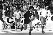 Allan Hewson attacks against France, 1981. New Zealand All Blacks. Photo: PHOTOSPORT/Peter Bush