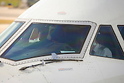 close up of a large airplane cockpit on eye level seen from outside