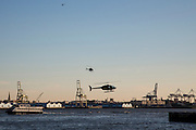 Helicopters fly close to the East River at dusk near the Downtown Manhattan/ Wall Street Heliport; Pier 6, Manhattan, New York City, New York, United States of America.  (photo by Andrew Aitchison / In pictures via Getty Images)